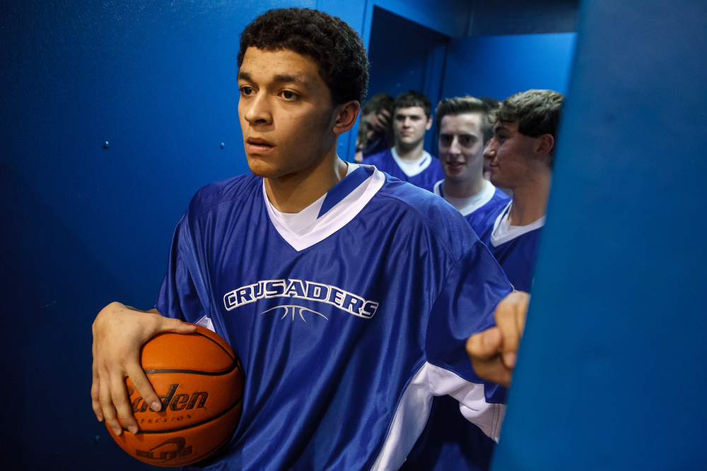 Lutheran's Pierson Wofford (35) waits to lead the team out on to the court to take on Calvary at Lutheran High School, Friday, Jan. 16, 2015, in Springfield, Ill. Justin L. Fowler/The State Journal-Register