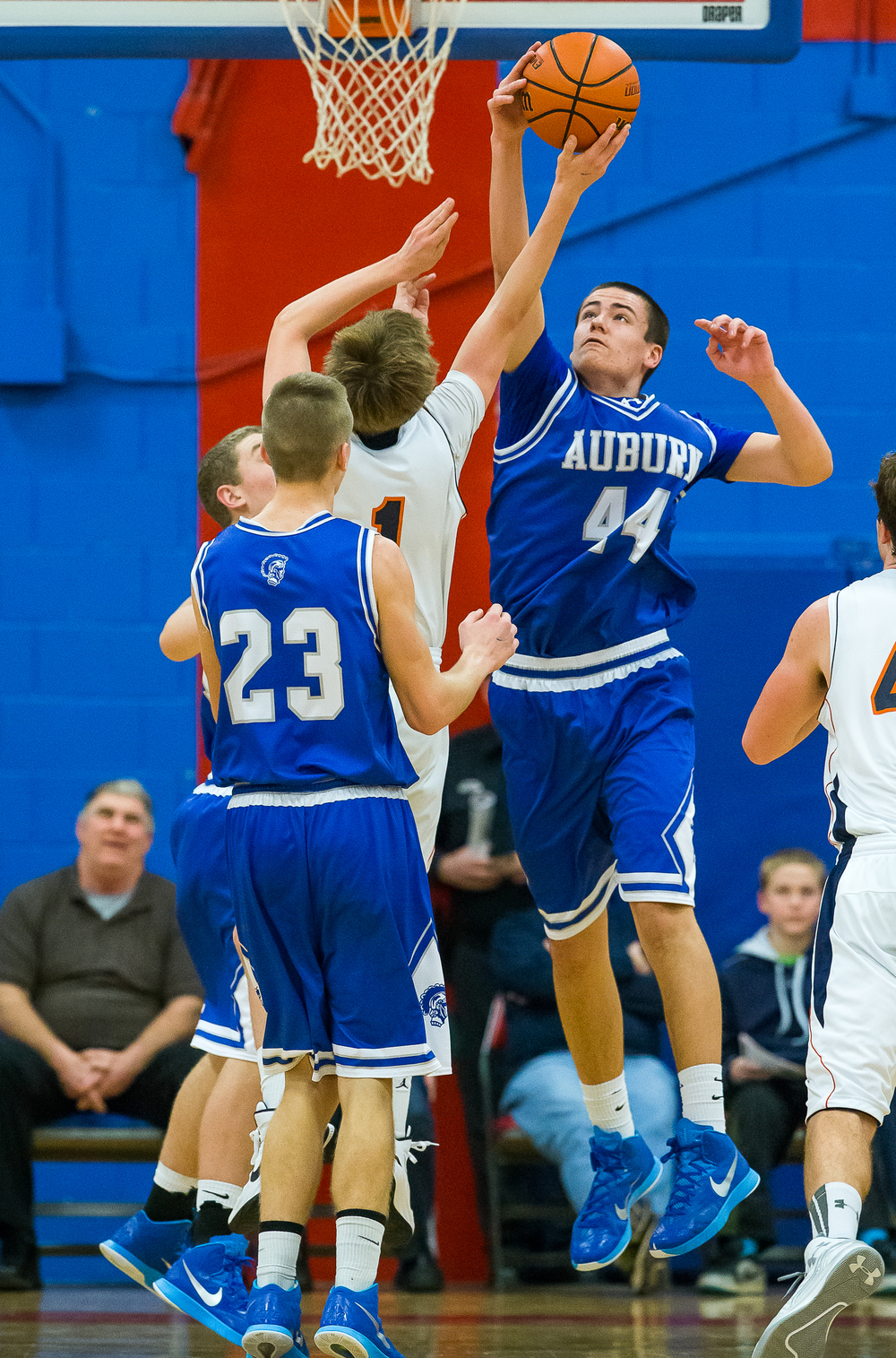 Auburn's Connor Berola (44) blocks a shot from Rochester's Dalton Handlin (1) in the second half during the Sangamon County Tournament championship game at Lincoln Land Community College's Cass Gymnasium, Saturday, Jan. 17, 2015, in Springfield, Ill. Justin L. Fowler/The State Journal-Register