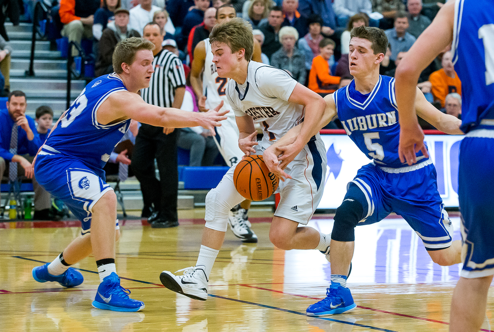 Rochester's Dalton Handlin (1) is fouled by Auburn's Drew Points (5) as he drives towards the basket in the first half during the Sangamon County Tournament championship game at Lincoln Land Community College's Cass Gymnasium, Saturday, Jan. 17, 2015, in Springfield, Ill. Justin L. Fowler/The State Journal-Register