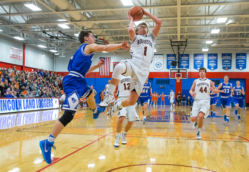 Rochester's Dalton Handlin (1) goes up for a layup against Auburn's Drew Points (5) on a fast break in the first half during the Sangamon County Tournament championship game at Lincoln Land Community College's Cass Gymnasium, Saturday, Jan. 17, 2015, in Springfield, Ill. Justin L. Fowler/The State Journal-Register