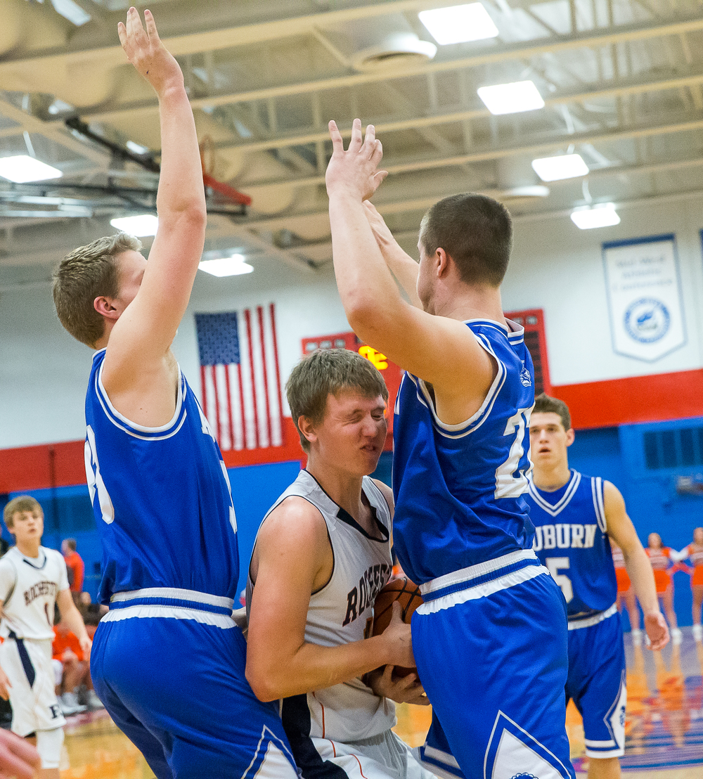 Rochester's Dan Zeigler (12) gets double teamed by Auburn's Cooper Eaker (33) and Scott McDermand (22) in the first half during the Sangamon County Tournament championship game at Lincoln Land Community College's Cass Gymnasium, Saturday, Jan. 17, 2015, in Springfield, Ill. Justin L. Fowler/The State Journal-Register
