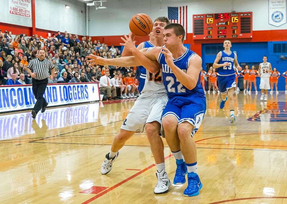 Auburn's Scott McDermand (22) and Rochester's Dan Zeigler (12) get tangled up as Zeigler goes to the basket  in the first half during the Sangamon County Tournament championship game at Lincoln Land Community College's Cass Gymnasium, Saturday, Jan. 17, 2015, in Springfield, Ill. Justin L. Fowler/The State Journal-Register