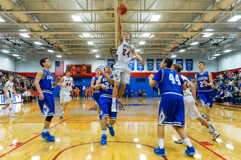 Rochester's Howard Fisher (24) blows through a hole in the Auburn defense for a layup in the first half during the Sangamon County Tournament championship game at Lincoln Land Community College's Cass Gymnasium, Saturday, Jan. 17, 2015, in Springfield, Ill. Fisher led the Rockets with 20 points.  Justin L. Fowler/The State Journal-Register