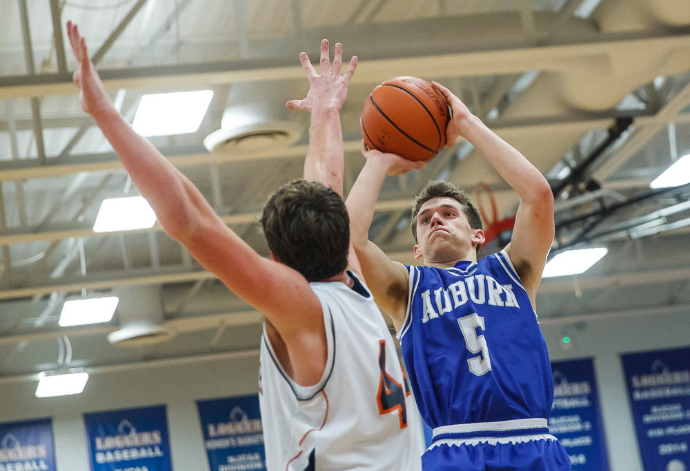 Auburn's Drew Points (5) puts up a basket against Rochester's Adam Conrady (44) in the second half during the Sangamon County Tournament championship game at Lincoln Land Community College's Cass Gymnasium, Saturday, Jan. 17, 2015, in Springfield, Ill. Justin L. Fowler/The State Journal-Register