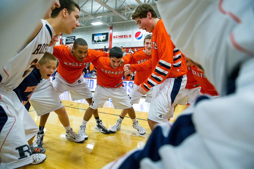 Rochester's Tristan Sutker (34) leads the team in their pregame ritual as the Rockets prepare to take on Auburn in the Sangamon County Tournament championship game at Lincoln Land Community College's Cass Gymnasium, Saturday, Jan. 17, 2015, in Springfield, Ill. Justin L. Fowler/The State Journal-Register
