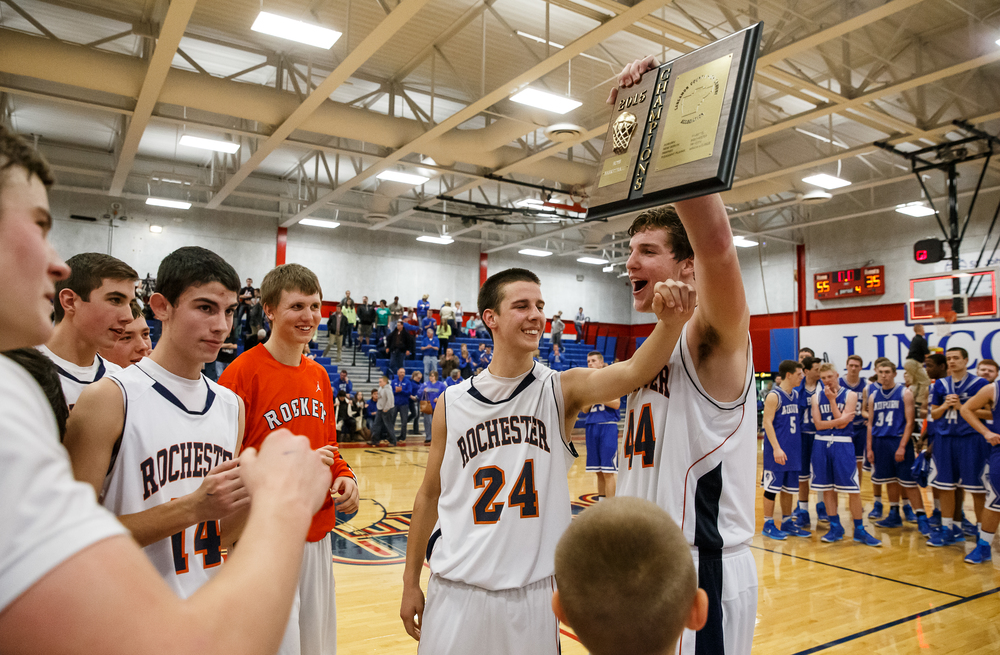 Rochester's Adam Conrady (44) holds up the championship plaque with Howard Fisher (24) after the Rockets defeated Auburn 55-35 in the Sangamon County Tournament championship game at Lincoln Land Community College's Cass Gymnasium, Saturday, Jan. 17, 2015, in Springfield, Ill. Justin L. Fowler/The State Journal-Register
