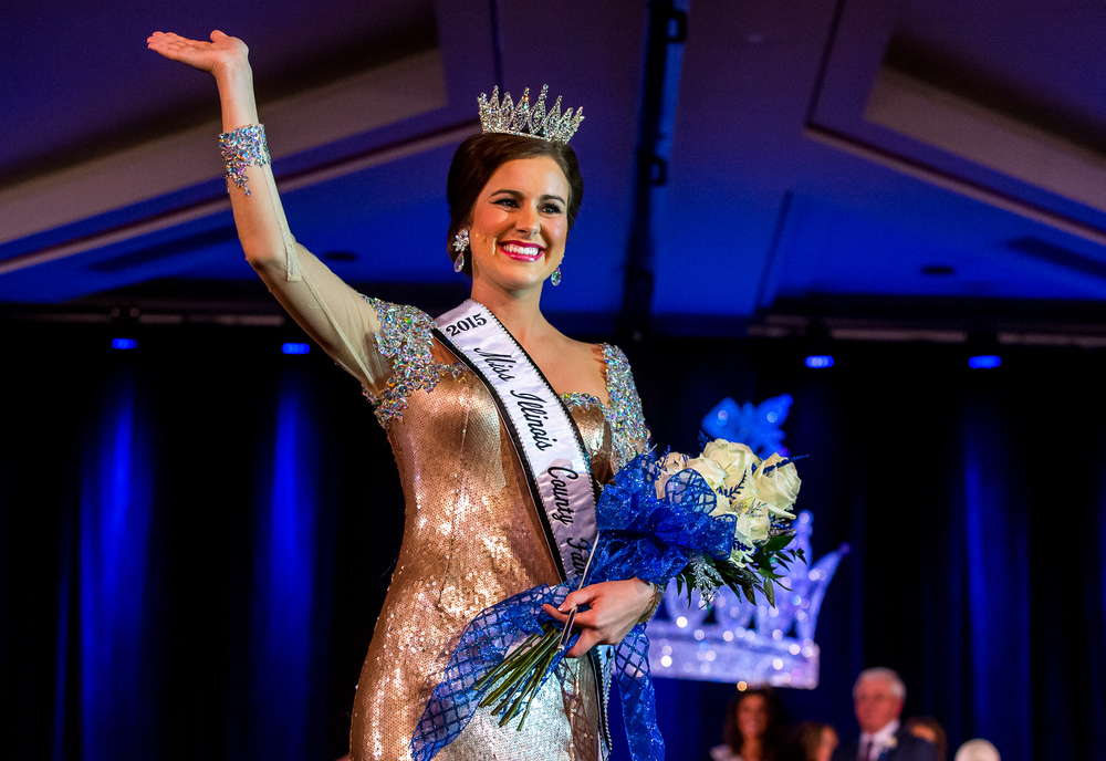 Sadie Gassmann, of Olney, Ill., takes her first walk as THE 2015 Miss Illinois County Fair Queen after receiving her crown during the 2015 Miss Illinois County Fair Queen Pageant at the Crowne Plaza, Sunday, Jan. 18, 2015, in Springfield, Ill. Justin L. Fowler/The State Journal-Register