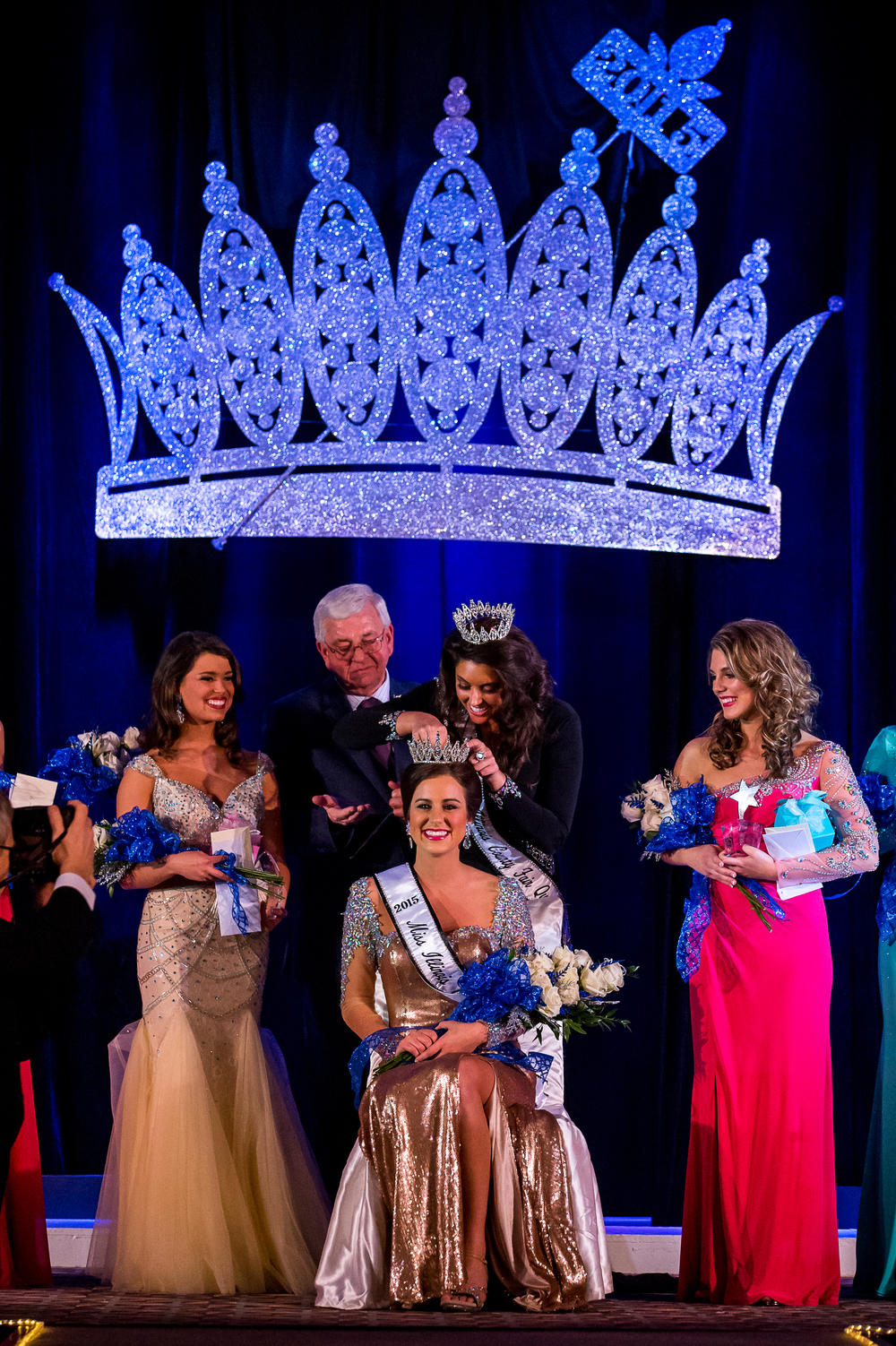 Sadie Gassmann, of Olney, Ill., receives her crown from the 2014 Queen Summer Robbins, as she is crowned the 2015 Miss Illinois County Fair Queen during the pageant at the Crowne Plaza, Sunday, Jan. 18, 2015, in Springfield, Ill. Justin L. Fowler/The State Journal-Register
