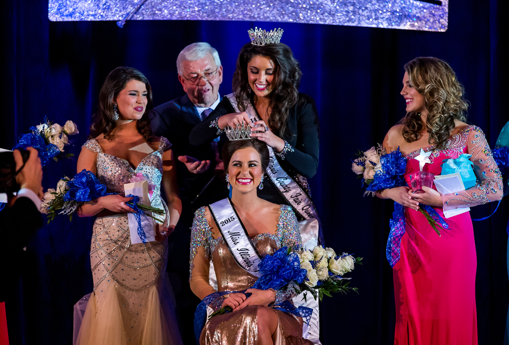Sadie Gassmann, of Olney, Ill., receives her crown from the 2014 Queen, Summer Robbins, as she is crowned the 2015 Miss Illinois County Fair Queen during the pageant at the Crowne Plaza, Sunday, Jan. 18, 2015, in Springfield, Ill. Justin L. Fowler/The State Journal-Register