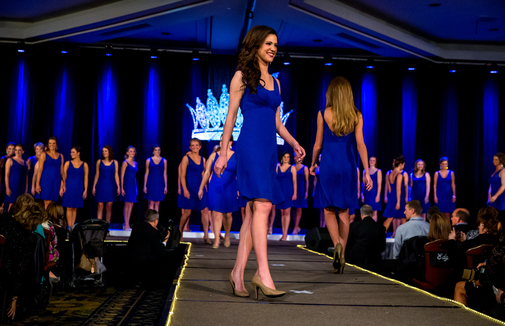 Miss Sangamon County Fair Queen 2014, Anna Washko, center, makes her introduction during the parade of contestants during the opening of the 2015 Miss Illinois County Fair Queen Pageant at the Crowne Plaza, Sunday, Jan. 18, 2015, in Springfield, Ill. Justin L. Fowler/The State Journal-Register