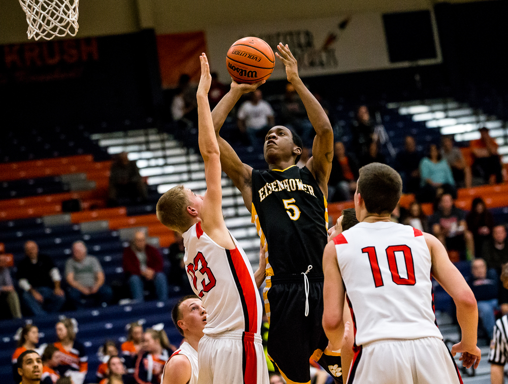 Decatur Eisenhower's DJ Smith (5) puts up a shot against Glenwood's Karson Aherin (23) in the first half during the CS8 Boys Basketball Tournament at the Rochester Athletic Complex, Monday, Jan. 19, 2015, in Springfield, Ill. Justin L. Fowler/The State Journal-Register