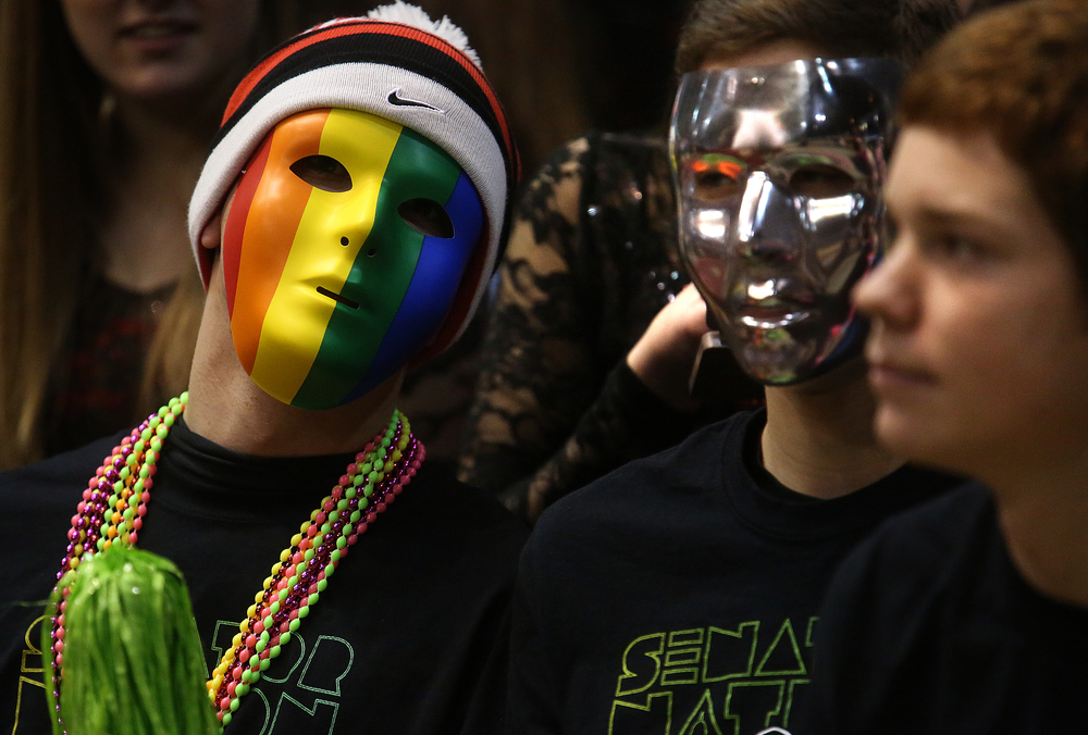Springfield senior Braden Masten got into the spirit by wearing a rainbow-colored mask while seated in the Senators student cheering section Thursday night. Springfield High School defeated Southeast 66-55 during first night action at the Boys City Basketball Tournament at the Prairie Capital Convention Center in Springfield on Thursday, Jan. 22, 2015. David Spencer/The State Journal-Register