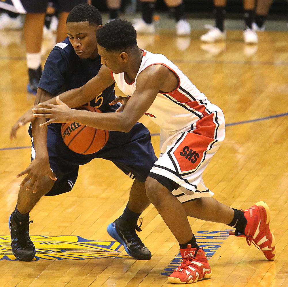 Southeast's Daimione Champion and Springfield player Isaac Nelson go after a loose ball. Springfield High School defeated Southeast 66-55 during first night action at the Boys City Basketball Tournament at the Prairie Capital Convention Center in Springfield on Thursday, Jan. 22, 2015. David Spencer/The State Journal-Register