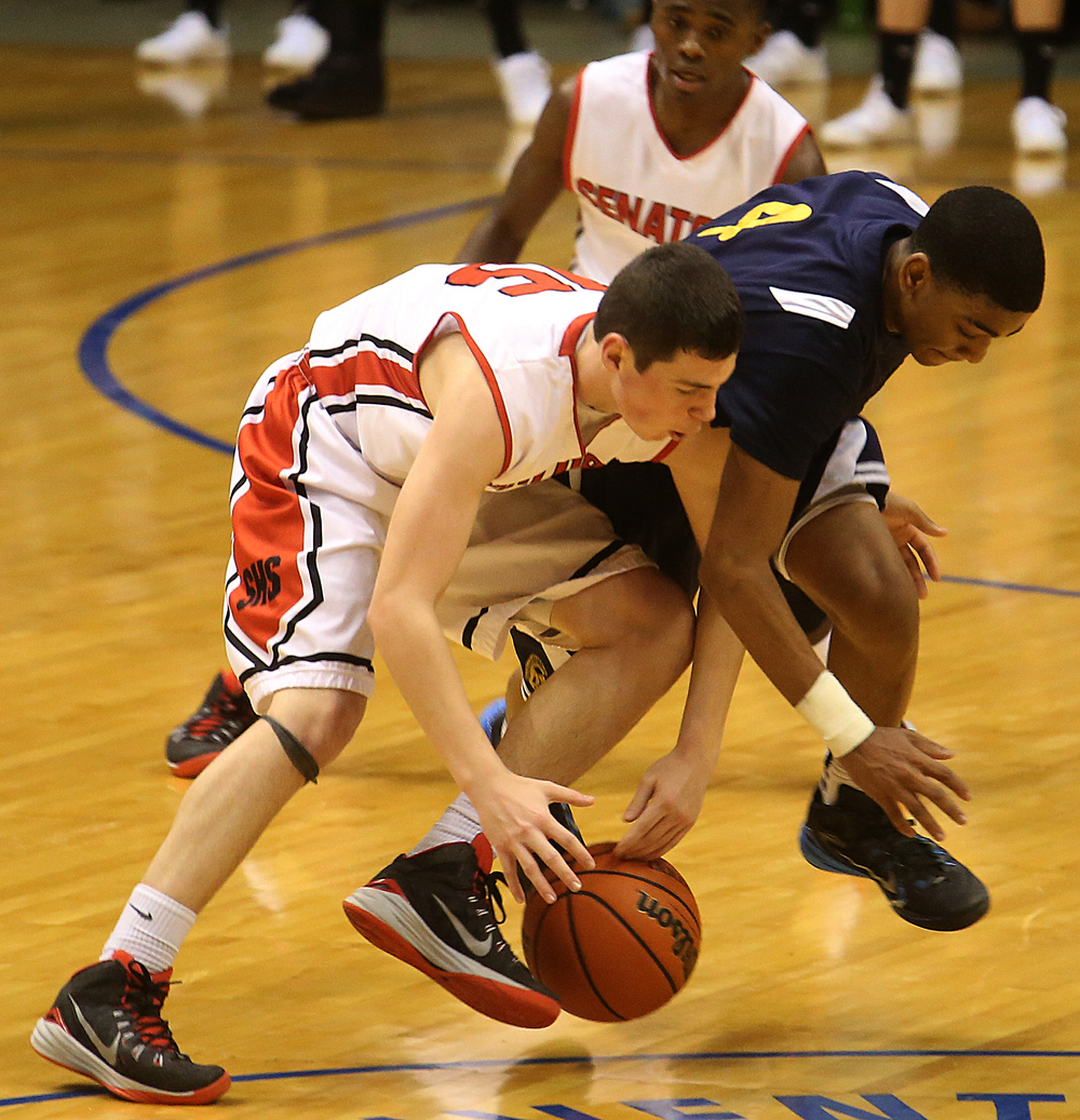 Springfield player Trevor Minder tries to control the ball under pressure from Southeast player Trevyon Williams. Springfield High School defeated Southeast 66-55 during first night action at the Boys City Basketball Tournament at the Prairie Capital Convention Center in Springfield on Thursday, Jan. 22, 2015. David Spencer/The State Journal-Register