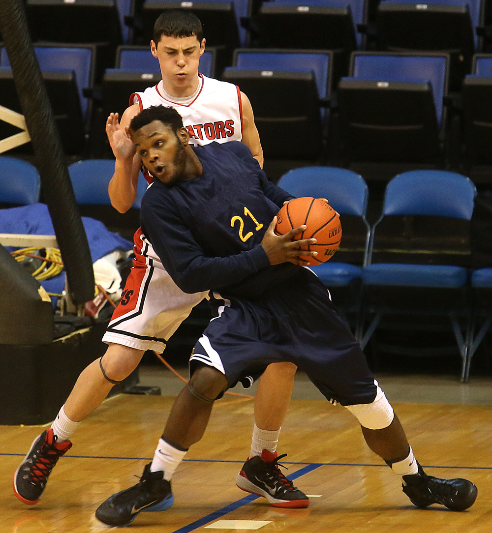 Southeast player D.J. Crawford looks for an open man under pressure from Springfield player Trevor Minder. Springfield High School defeated Southeast 66-55 during first night action at the Boys City Basketball Tournament at the Prairie Capital Convention Center in Springfield on Thursday, Jan. 22, 2015. David Spencer/The State Journal-Register