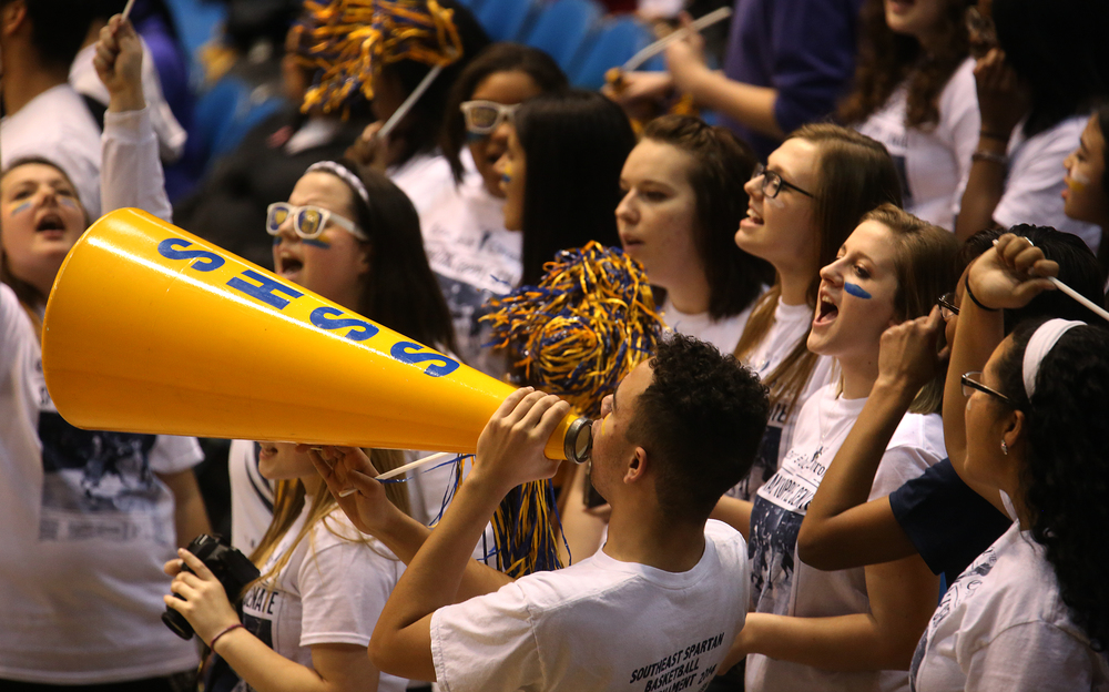 The Southeast student cheering section shows their enthusiasm. Springfield High School defeated Southeast 66-55 during first night action at the Boys City Basketball Tournament at the Prairie Capital Convention Center in Springfield on Thursday, Jan. 22, 2015. David Spencer/The State Journal-Register