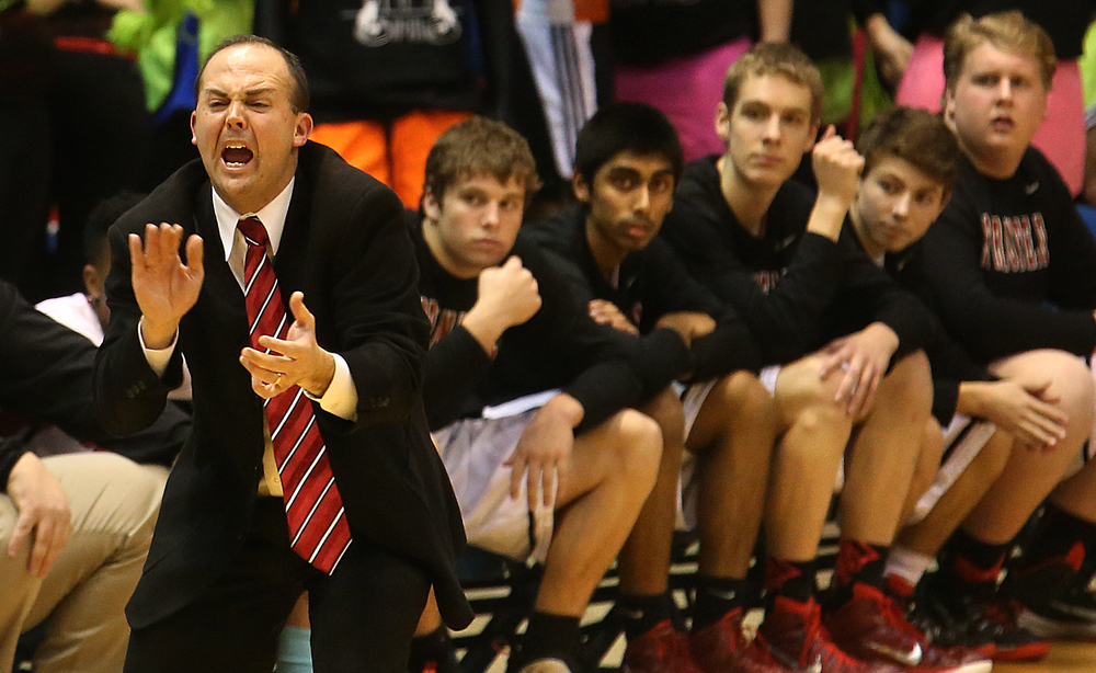 Springfield head coach Matt Reed yells to his players from the sidelines. Springfield High School defeated Southeast 66-55 during first night action at the Boys City Basketball Tournament at the Prairie Capital Convention Center in Springfield on Thursday, Jan. 22, 2015. David Spencer/The State Journal-Register