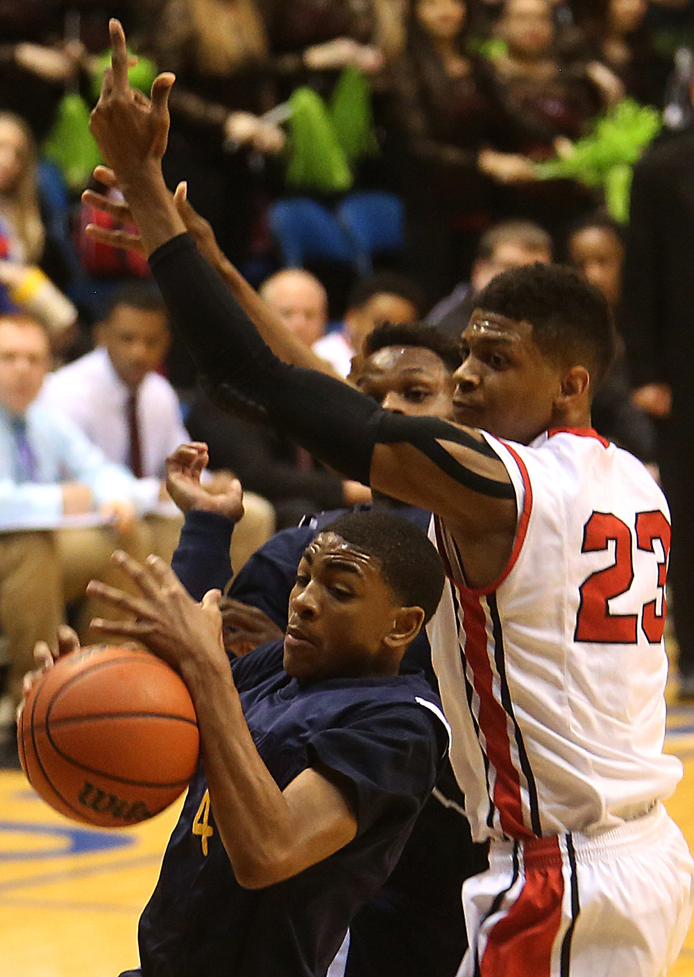Southeast's Trevyon Williams tries to gain control of the ball while under pressure by Springfield's Obediah Church. Springfield High School defeated Southeast 66-55 during first night action at the Boys City Basketball Tournament at the Prairie Capital Convention Center in Springfield on Thursday, Jan. 22, 2015. David Spencer/The State Journal-Register