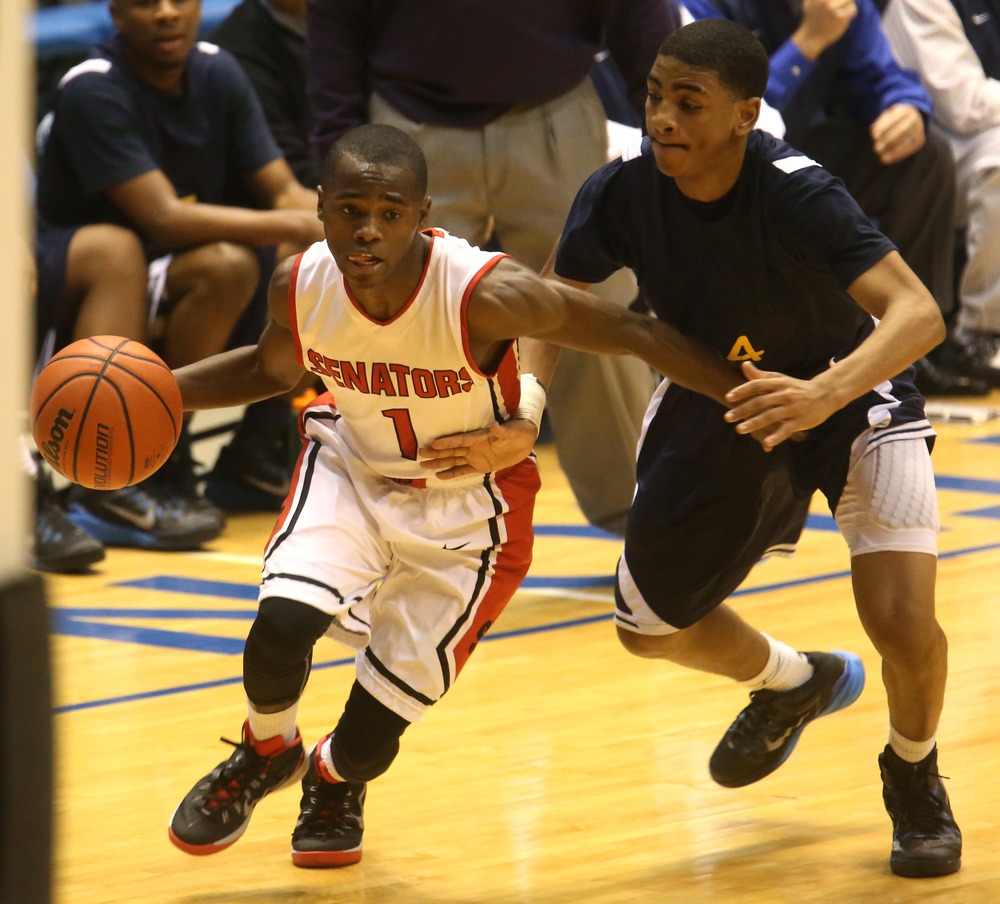 Springfield player Taivon Kincaid drives to the basket while in pursuit by Southeast's Trevyon Williams. Springfield High School defeated Southeast 66-55 during first night action at the Boys City Basketball Tournament at the Prairie Capital Convention Center in Springfield on Thursday, Jan. 22, 2015. David Spencer/The State Journal-Register
