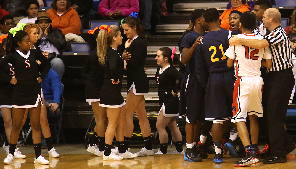 Springfield cheerleaders react while a scuffle between both sides is broken up by a referee in second half action. Springfield High School defeated Southeast 66-55 during first night action at the Boys City Basketball Tournament at the Prairie Capital Convention Center in Springfield on Thursday, Jan. 22, 2015. David Spencer/The State Journal-Register