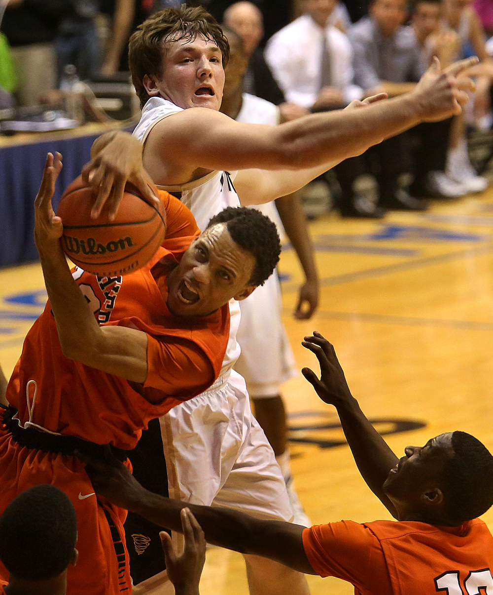 Lanphier player Daryl Jackson pulls down a rebound under pressure from Sacred Heart-Griffin's Michael Zeigler. Lanphier High School defeated Sacred Heart-Griffin 73-42 during first night action at the Boys City Basketball Tournament at the Prairie Capital Convention Center in Springfield on Thursday, Jan. 22, 2015. David Spencer/The State Journal-Register