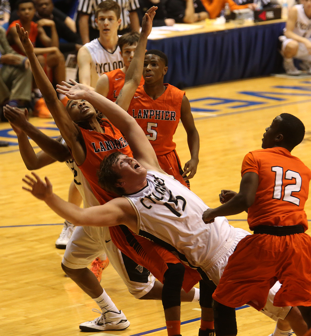 Lanphier player Aarin Thames and SHG player Michael Zeigler fall in unison while looking for the rebound. Lanphier High School defeated Sacred Heart-Griffin 73-42 during first night action at the Boys City Basketball Tournament at the Prairie Capital Convention Center in Springfield on Thursday, Jan. 22, 2015. David Spencer/The State Journal-Register