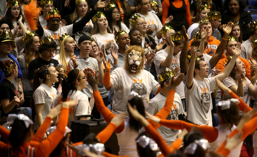 Members of the Lanphier student cheering section show their enthusiasm. Lanphier High School defeated Sacred Heart-Griffin 73-42 during first night action at the Boys City Basketball Tournament at the Prairie Capital Convention Center in Springfield on Thursday, Jan. 22, 2015. David Spencer/The State Journal-Register