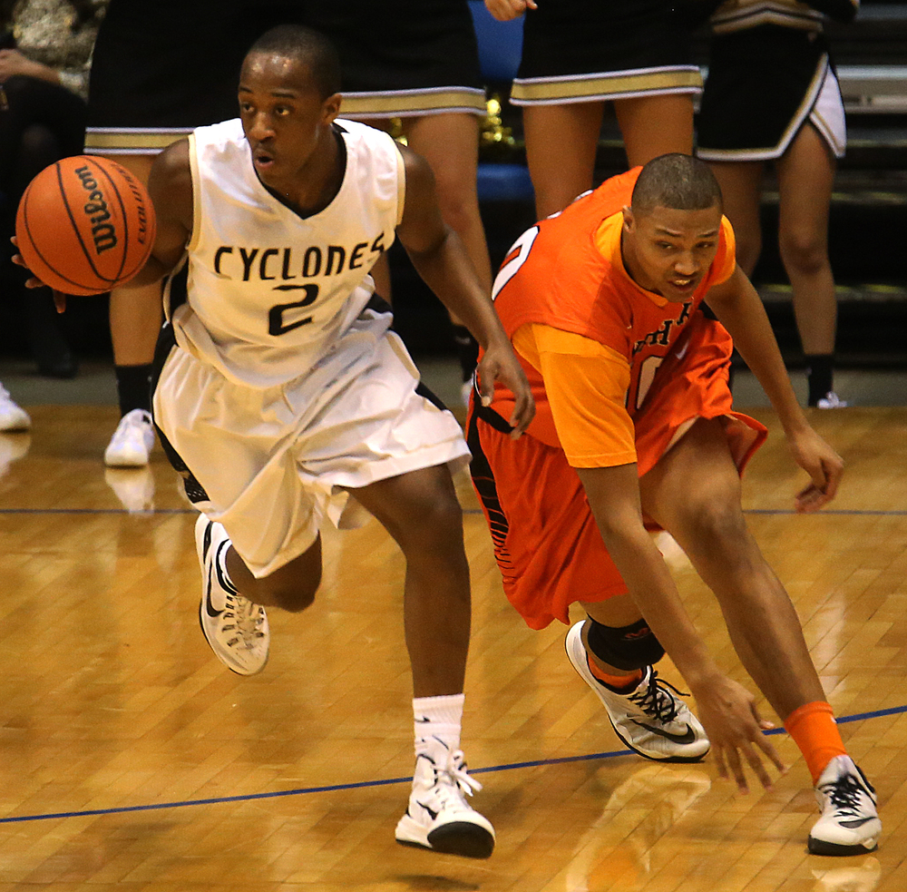 Sacred Heart-Griffin player Avery Andrews gets past Lanphier player Davon Harris. Lanphier High School defeated Sacred Heart-Griffin 73-42 during first night action at the Boys City Basketball Tournament at the Prairie Capital Convention Center in Springfield on Thursday, Jan. 22, 2015. David Spencer/The State Journal-Register