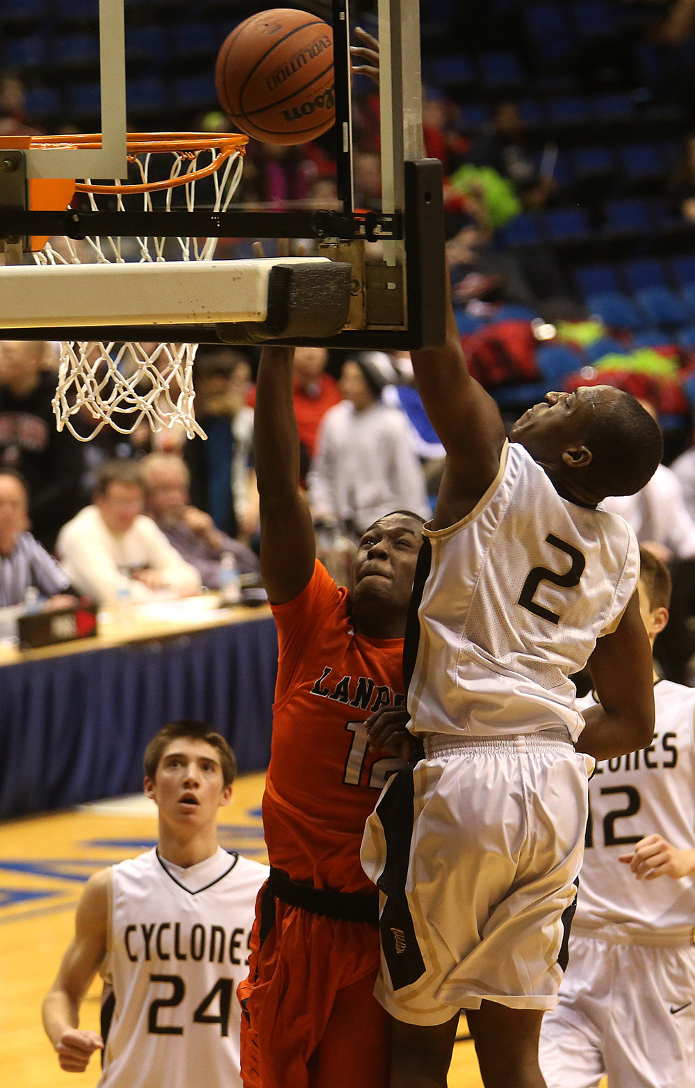 Lanphier player Jordan Tribbet tries to block a shot being made by Sacred Heart-Griffin player Avery Andrews. Lanphier High School defeated Sacred Heart-Griffin 73-42 during first night action at the Boys City Basketball Tournament at the Prairie Capital Convention Center in Springfield on Thursday, Jan. 22, 2015. David Spencer/The State Journal-Register