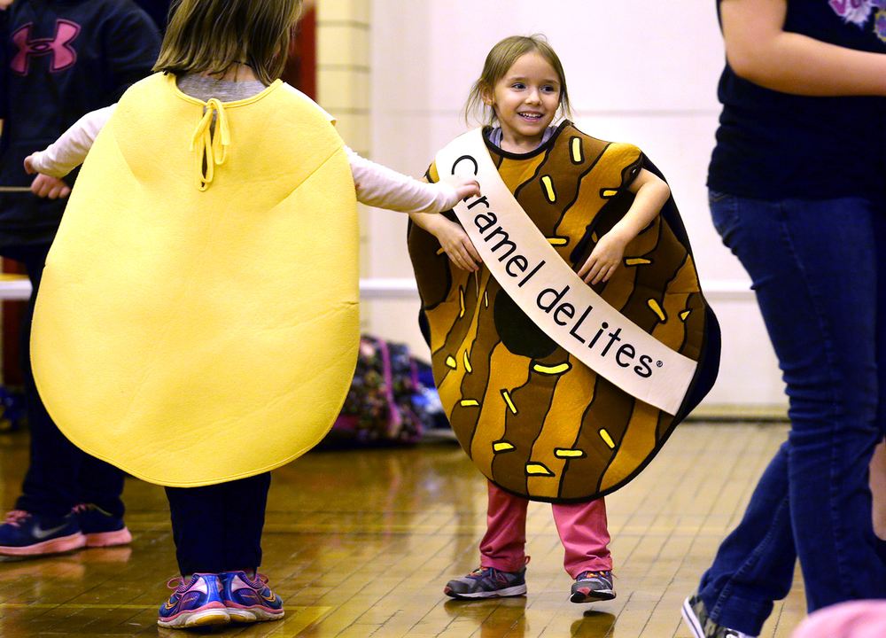 Having fun wearing cookie costumes during the rally are Amara Kaeding at right and Rachel Holtgrave of Troop #6292 in Springfield. A Girl Scout cookie rally in support of the annual sale kicking off February 13 took place by troop members affiliated with the Girl Scouts of Central Illinois at the Springfield YMCA on Saturday evening, Jan. 17, 2015. Approximately 225 Girl Scouts from 50 area troops took part in the event along with an additional 115 parents and troop leaders. David Spencer/The State Journal-Register
