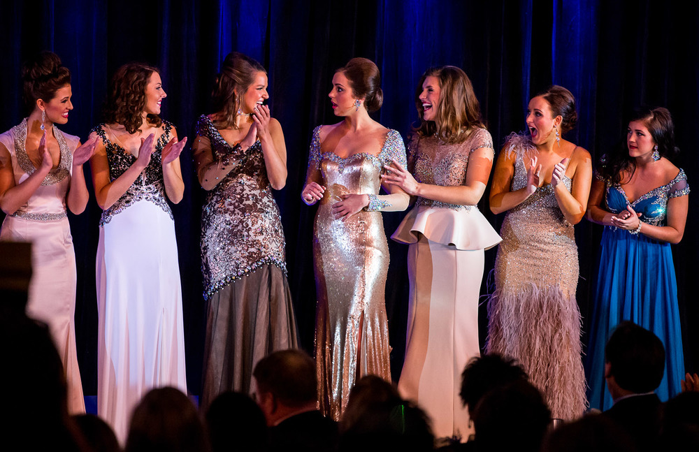 Miss Richland County Fair Queen 2014, Sadie Gassmann, of Olney, Ill., center, reacts as her name is called to be the 2015 Miss Illinois County Fair Queen during the pageant at the Crowne Plaza, Sunday, Jan. 18, 2015, in Springfield, Ill. Justin L. Fowler/The State Journal-Register