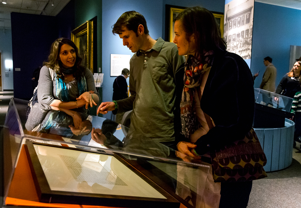 "Sarah Williams, left, and her husband, Joseph, center, discuss the handwritten copy of the Gettysburg Address on display with their friend, Anna Morell, right, of Sacramento, Calif., inside the ""Undying Words"" exhibition at the Abraham Lincoln Presidential Museum, Monday, Jan. 19, 2015, in Springfield, Ill. The document is being taken out of the exhibition and put back in the vault to minimize it's exposure after being on display off and on over the past few years. Justin L. Fowler/The State Journal-Register"