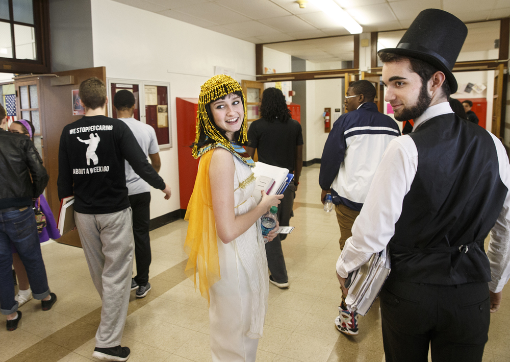 Courtney Henson and Ethan Conley-Keck glance back at an approaching classmate as they make their way to a literature class dressed as characters from the past at Springfield High School Wednesday, Jan. 21, 2015. The pair were joined by hundreds of other students dressed up as part of City Tourney Spirit Week.  Ted Schurter/The State Journal-Register