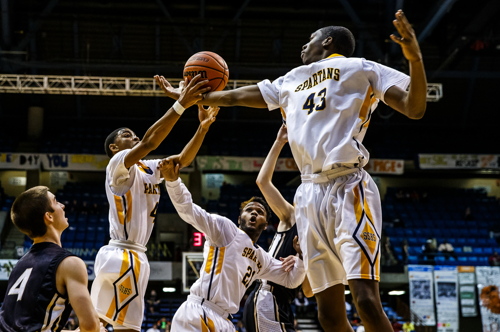 Southeast's Darius Ousley (43) and Trevyon Williams (4) go for a rebound against SHG in the first half during game one of the 2015 Boys City Tournament at the Prairie Capital Convention Center, Friday, Jan. 23, 2015, in Springfield, Ill. Justin L. Fowler/The State Journal-Register