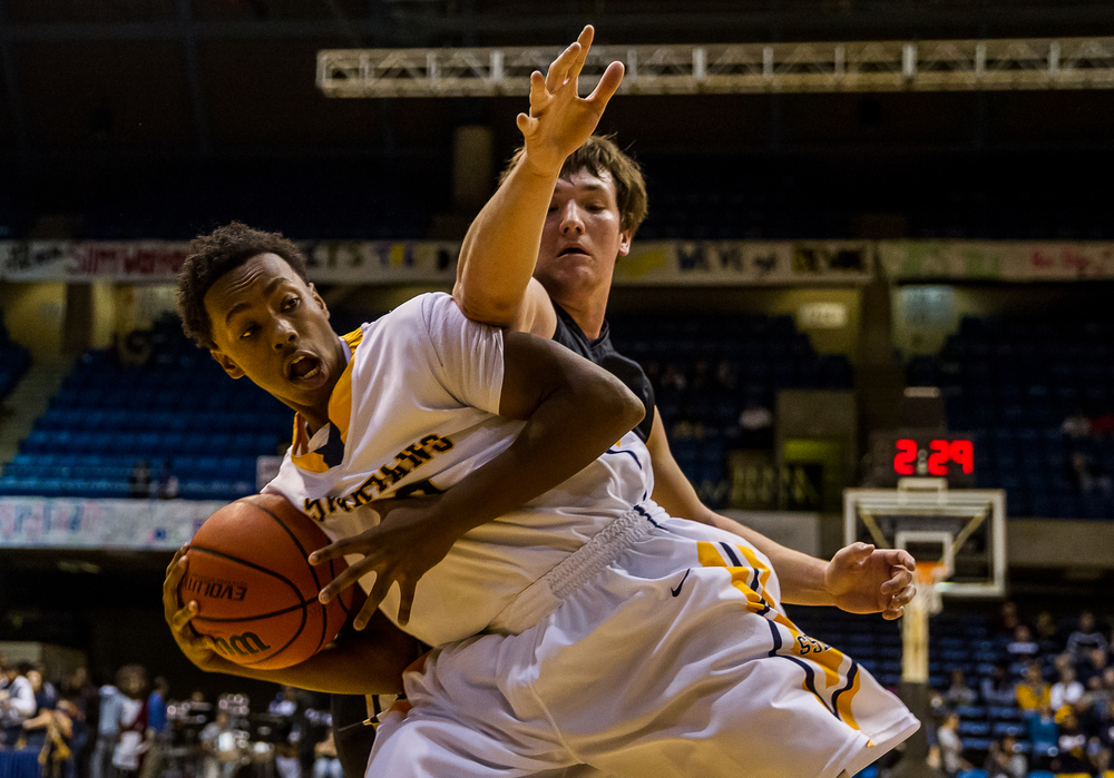 Southeast's Mark Johnson (33) wins a rebound against Sacred Heart-Griffin's Michael Zeigler (15) in the first half during game one of the 2015 Boys City Tournament at the Prairie Capital Convention Center, Friday, Jan. 23, 2015, in Springfield, Ill. Justin L. Fowler/The State Journal-Register