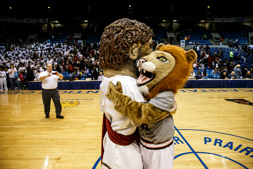 The Lanpheir Lion and the Springfield Solon hug it out after the Lions defeated Springfield 74-67 during game two of the 2015 Boys City Tournament at the Prairie Capital Convention Center, Friday, Jan. 23, 2015, in Springfield, Ill. Justin L. Fowler/The State Journal-Register