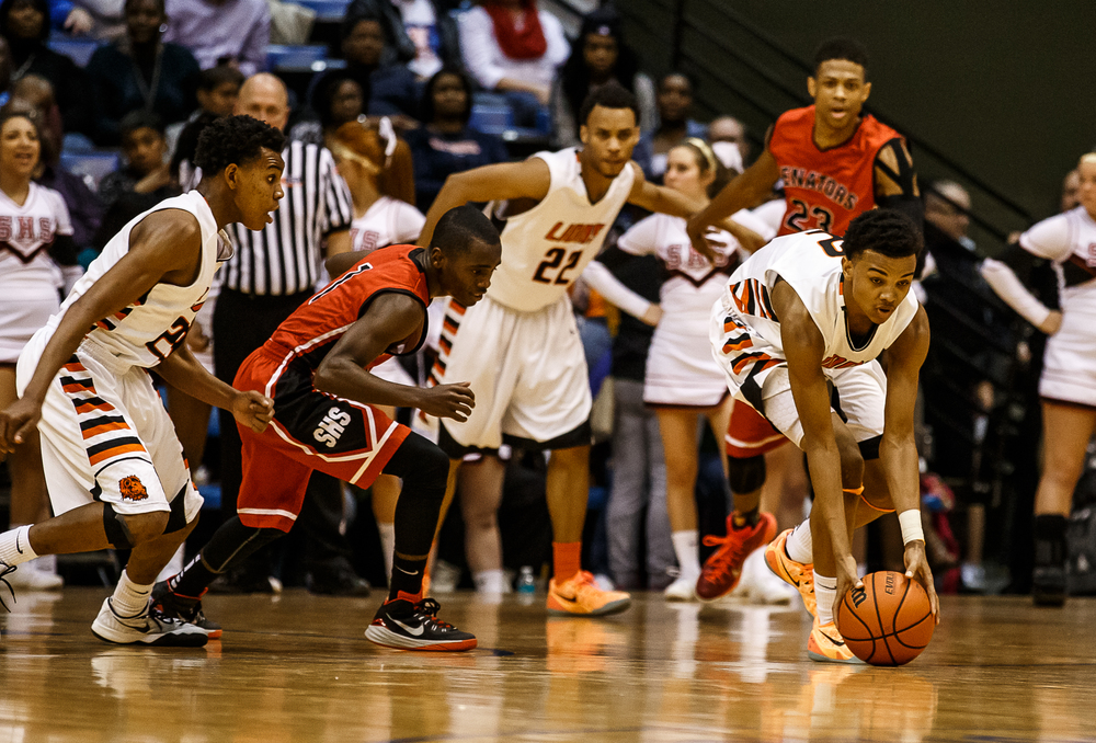 Lanphier's Cardell McGee (2) pics up a loose ball knocked away from Springfield's Taivon Kincaid (1) in the second half during game two of the 2015 Boys City Tournament at the Prairie Capital Convention Center, Friday, Jan. 23, 2015, in Springfield, Ill. Justin L. Fowler/The State Journal-Register