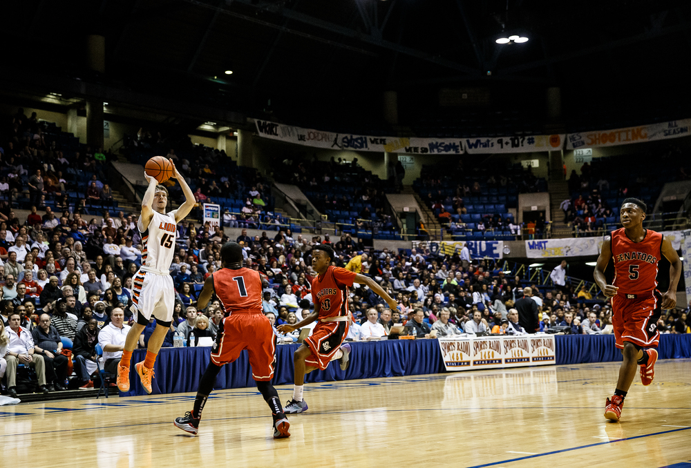Lanphier's Nick Patton (15) fires a three in front of Springfield's Taivon Kincaid (1) in the first half during game two of the 2015 Boys City Tournament at the Prairie Capital Convention Center, Friday, Jan. 23, 2015, in Springfield, Ill. Justin L. Fowler/The State Journal-Register