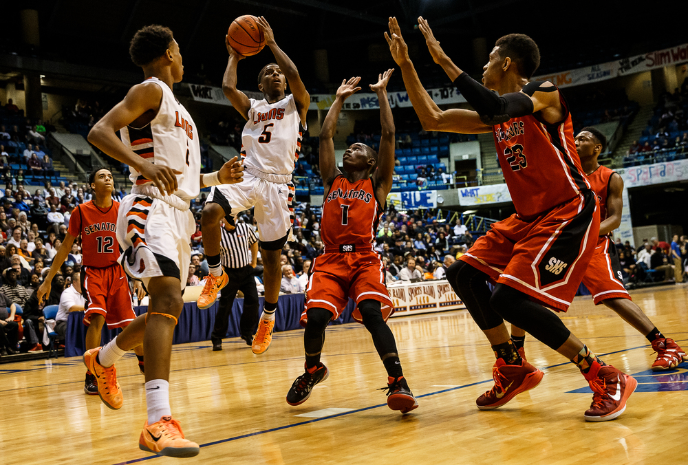 Lanphier's Xavier Bishop (5) goes up for a basket after going around Springfield's Taivon Kincaid (1) in the first half during game two of the 2015 Boys City Tournament at the Prairie Capital Convention Center, Friday, Jan. 23, 2015, in Springfield, Ill. Justin L. Fowler/The State Journal-Register