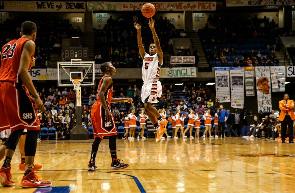 Lanphier's Xavier Bishop (5) fires a three pointer against Springfield in the first half during game two of the 2015 Boys City Tournament at the Prairie Capital Convention Center, Friday, Jan. 23, 2015, in Springfield, Ill. Justin L. Fowler/The State Journal-Register
