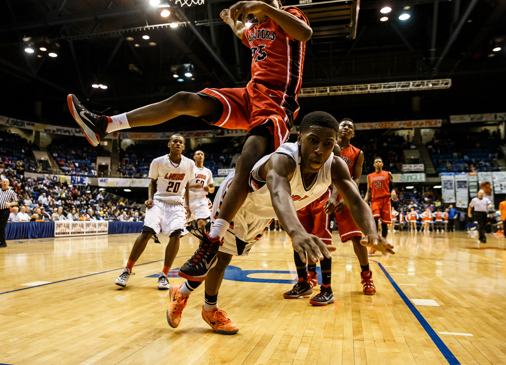 Lanphier's Xavier Bishop (5) is fouled by Springfield's Marquiss Johnson (25) while going up for a basket in the first half during game two of the 2015 Boys City Tournament at the Prairie Capital Convention Center, Friday, Jan. 23, 2015, in Springfield, Ill. Justin L. Fowler/The State Journal-Register