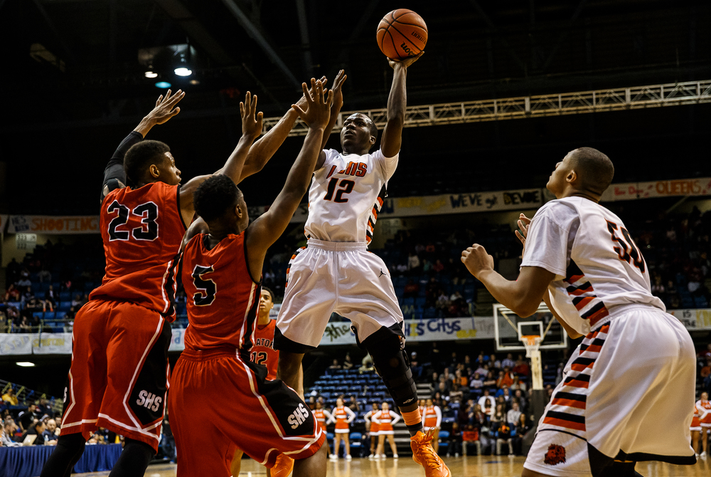 Lanphier's Jordan Tribbet (12) fires off a shot against Springfield's Obediah Church (23) and Isaac Nelson (5) in the first half during game two of the 2015 Boys City Tournament at the Prairie Capital Convention Center, Friday, Jan. 23, 2015, in Springfield, Ill. Justin L. Fowler/The State Journal-Register