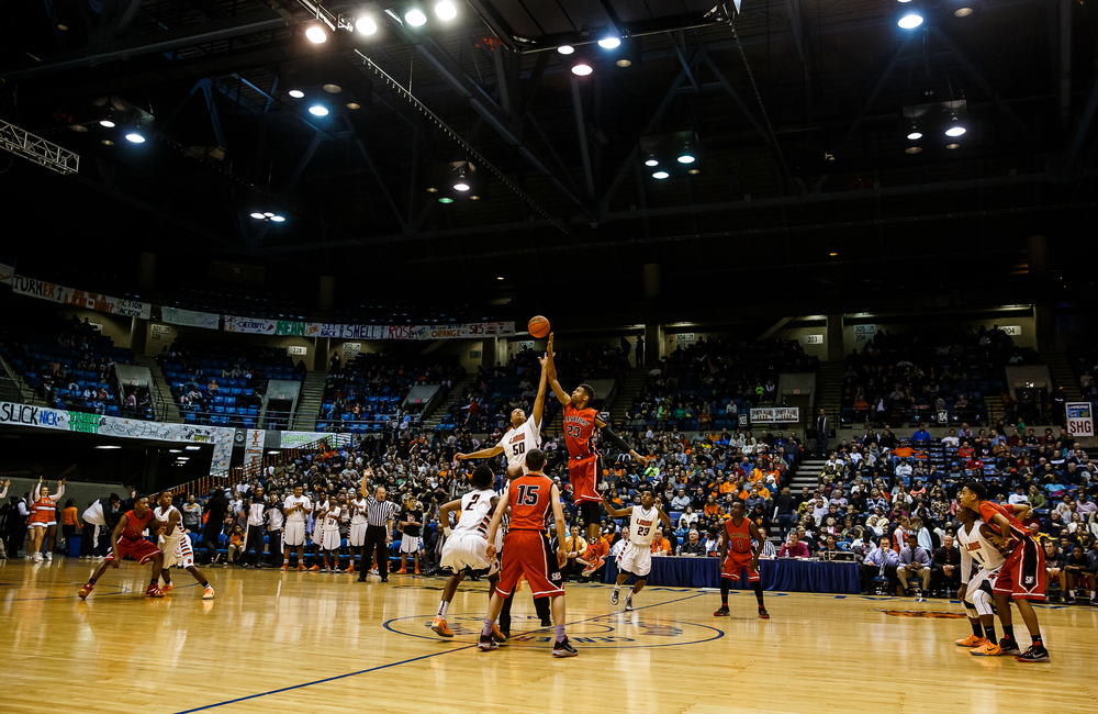 Springfield's Obediah Church (23) wins the opening tip against Lanphier's Davon Harris (50) in the first half during game two of the 2015 Boys City Tournament at the Prairie Capital Convention Center, Friday, Jan. 23, 2015, in Springfield, Ill. Justin L. Fowler/The State Journal-Register