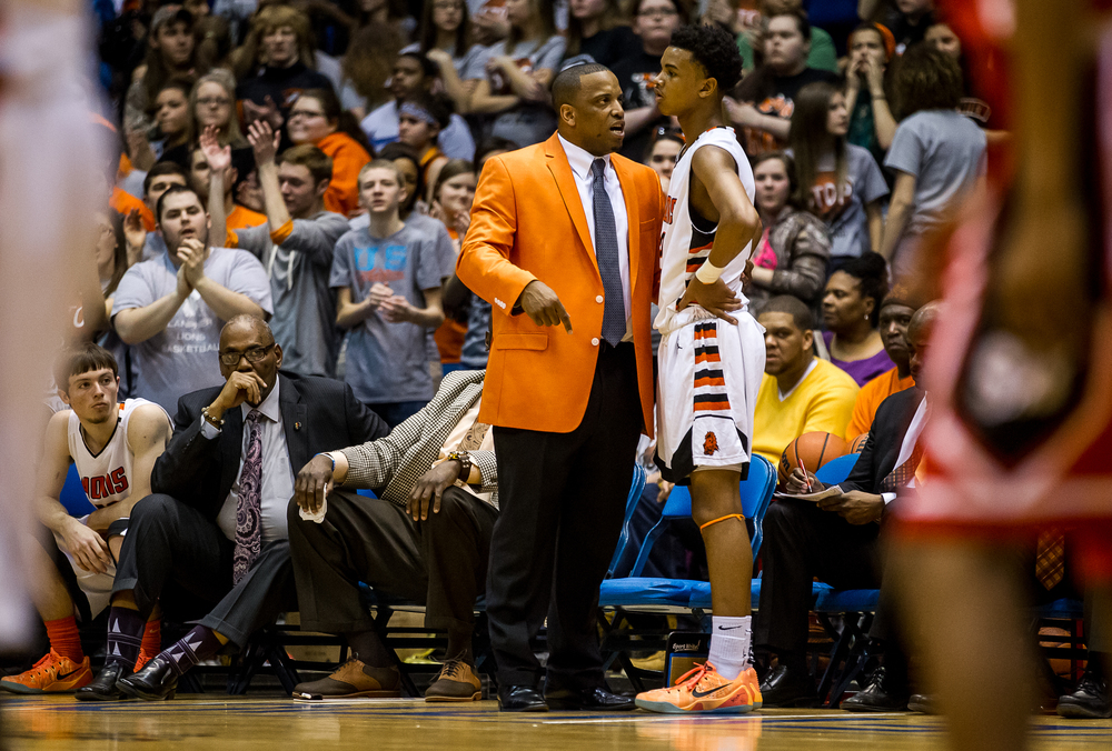 Lanphier boys basketball head coach Blake Turner talks with Lanphier's Cardell McGee (2) on the sidelines as the Lions take on Springfield in the first half during game two of the 2015 Boys City Tournament at the Prairie Capital Convention Center, Friday, Jan. 23, 2015, in Springfield, Ill. Justin L. Fowler/The State Journal-Register