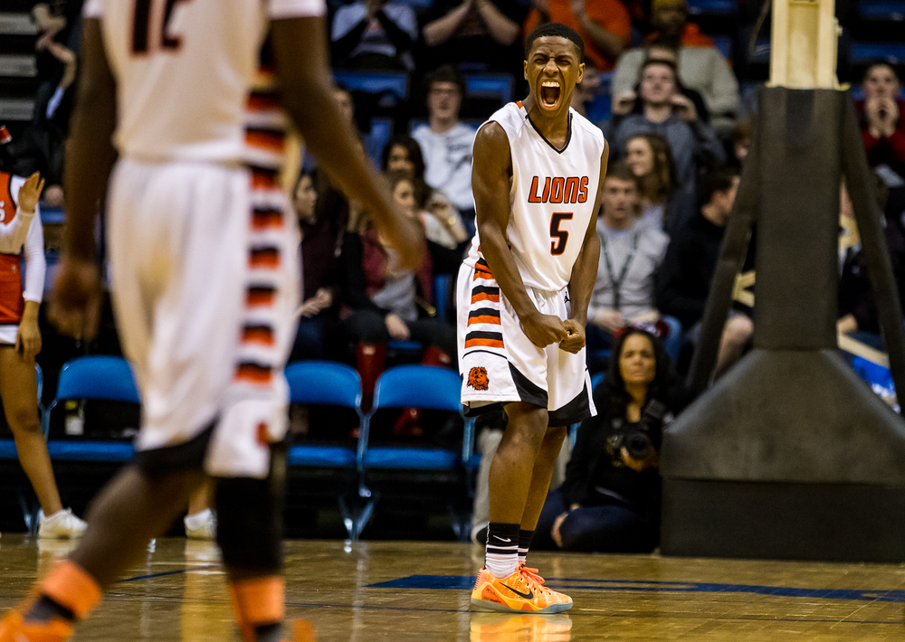 Lanphier's Xavier Bishop (5) screams out after knocking down a three against Springfield in the first half during game two of the 2015 Boys City Tournament at the Prairie Capital Convention Center, Friday, Jan. 23, 2015, in Springfield, Ill. Bishop had 26 points for the Lions in the first half. Justin L. Fowler/The State Journal-Register