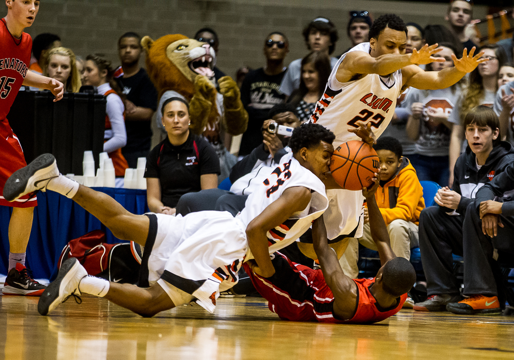 Lanphier's Aundrae Williams (23) is hit the face as he goes for a loose ball against Springfield's Taivon Kincaid (1) in the first half during game two of the 2015 Boys City Tournament at the Prairie Capital Convention Center, Friday, Jan. 23, 2015, in Springfield, Ill. Justin L. Fowler/The State Journal-Register