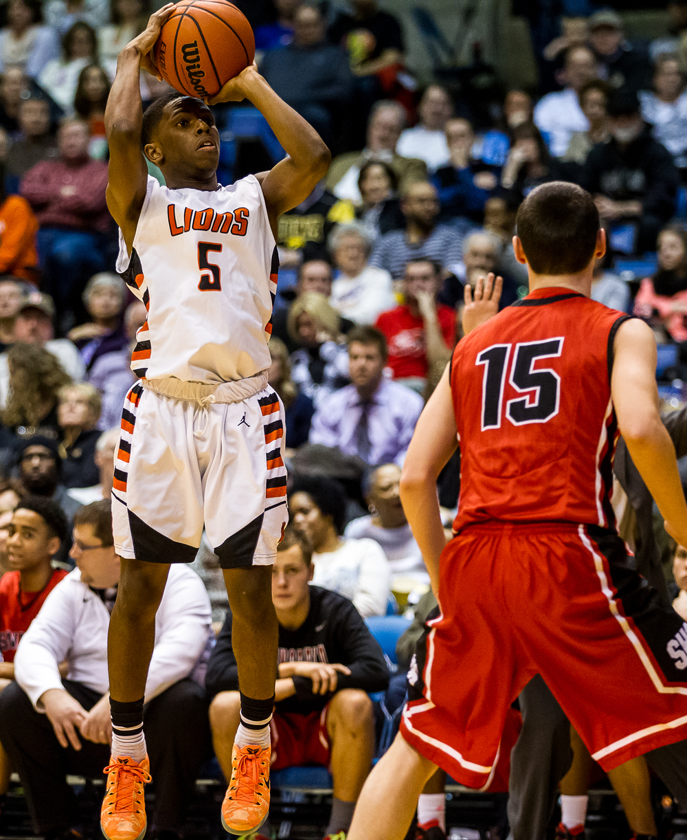 Lanphier's Xavier Bishop (5) sights in one of his five first half three pointers against Springfield in the first half during game two of the 2015 Boys City Tournament at the Prairie Capital Convention Center, Friday, Jan. 23, 2015, in Springfield, Ill. Justin L. Fowler/The State Journal-Register