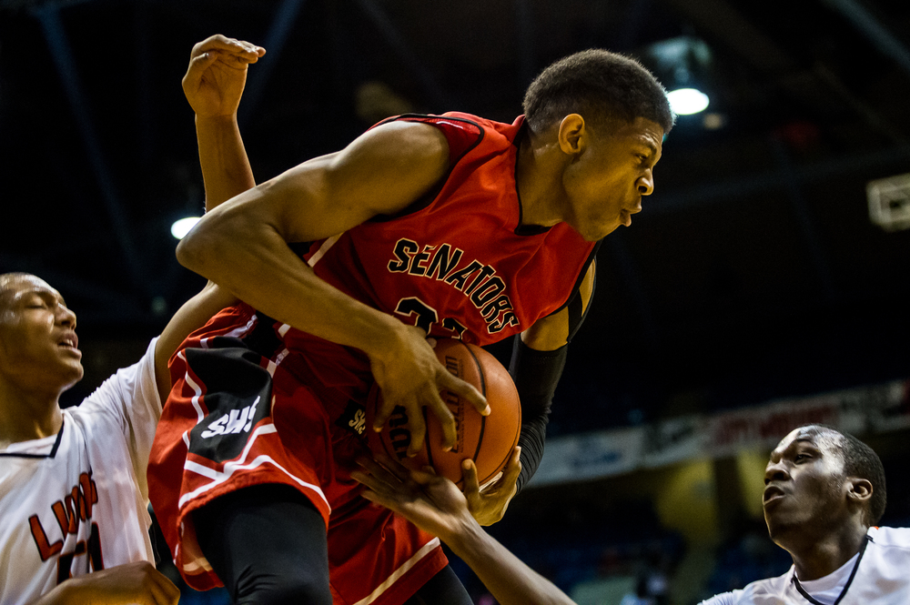 Springfield's Obediah Church (23) battles for a rebound underneath the basket against Lanphier in the first half during game two of the 2015 Boys City Tournament at the Prairie Capital Convention Center, Friday, Jan. 23, 2015, in Springfield, Ill. Justin L. Fowler/The State Journal-Register