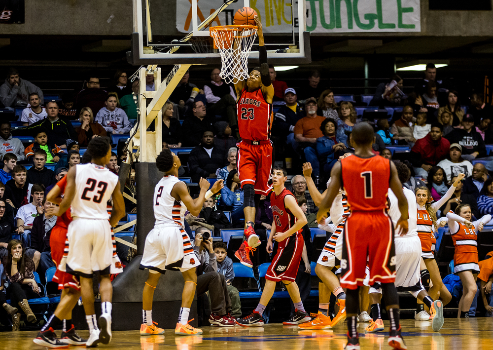 Springfield's Obediah Church (23) goes in for a dunk against Lanphier in the first half during game two of the 2015 Boys City Tournament at the Prairie Capital Convention Center, Friday, Jan. 23, 2015, in Springfield, Ill. Justin L. Fowler/The State Journal-Register