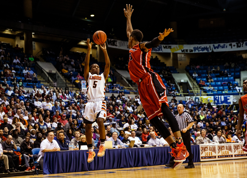 Lanphier's Xavier Bishop (5) puts up a shot over Springfield's Obediah Church (23) in the first half during game two of the 2015 Boys City Tournament at the Prairie Capital Convention Center, Friday, Jan. 23, 2015, in Springfield, Ill. Bishop had 26 points on 9-11 shooting and 5-7 from beyond three point range in the first half. Justin L. Fowler/The State Journal-Register